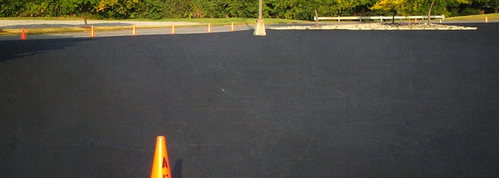 Hot crack filling and resurfacing of parking lot.
