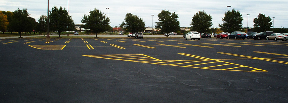Hot crack filling, sealcoating and striping of local mall parking lot.