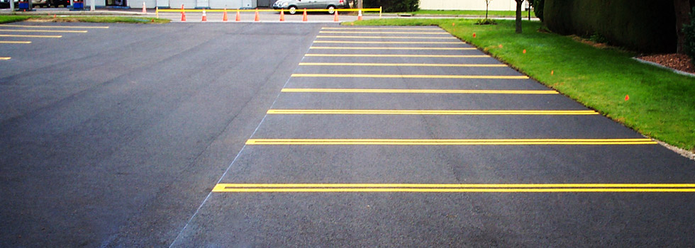 Parking lot overlay and pavement marking for local business.
