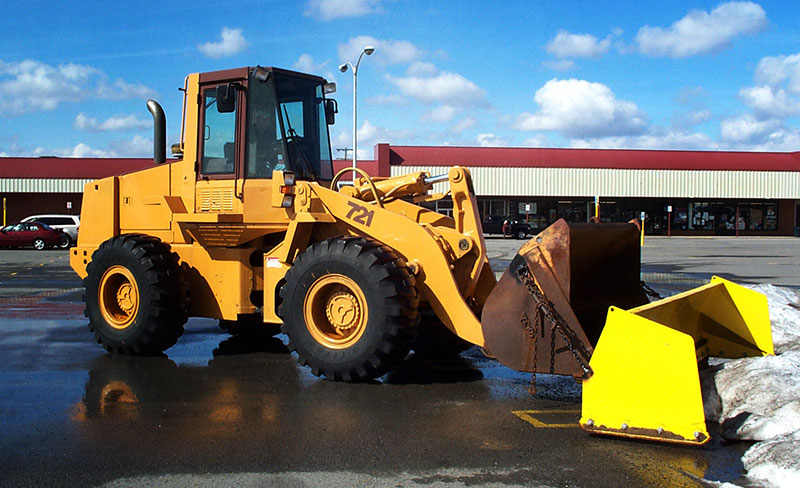 Make your parking lot safe with our commercial snow plowing services