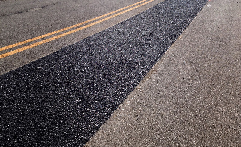 Fixing commercial parking lots and roadways with patching